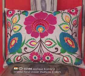 appliqued and embroidered cushion covers