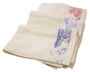 toile de jouy trimmed towels