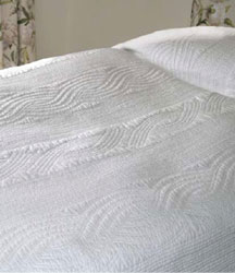 white scroll bed cover
