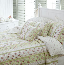 wild rose patchwork quilt on lime and ivory background hand quilted