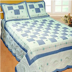 angela blue patchwork quilt with shams