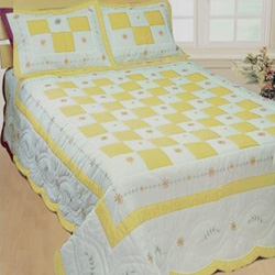 angela yellow patchwork quilt with shams