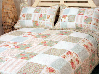 cayman blue floral and duck egg patchwork quilt with lace trim