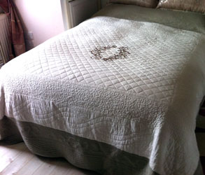 marseilled ivory and taupe embroiderede quilted bedspread