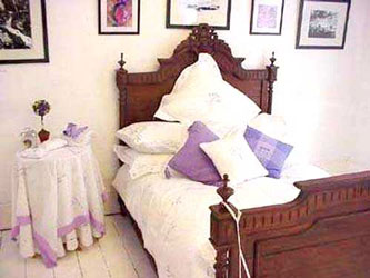 lavender bed linen on a French antique bed
