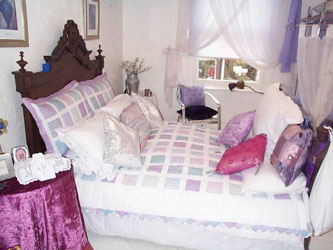 lilac and white patchwork bedspread