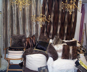 wolf leopard and cheetah faux fur throw display with faux fur cushions