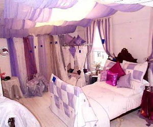 lilac and white striped curtains and matching bedding