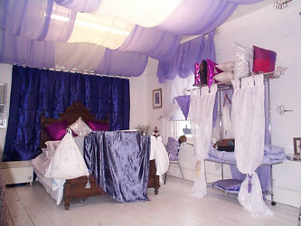 lilac decor with french antique bed and chrome furniture