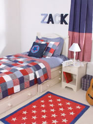tartan check patchwork quilt and cushion