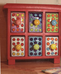 red wooden and dotty ceramic spice drawer